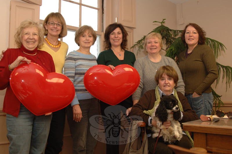 Promoting the Women's Heart Health campaign Wear Red in February, the Newtown VNA has scheduled a kick-off breakfast at My Place Restaurant on February 2 at 9:30 am. Guests Dr Robert Grossman and Dr Thomas Draper will be available for discussion and information. From left are Mae Schmidle, Mary Tietjen, Becky Smith, Rebeka Dahlgard, Anna Wiedemann, Jill Collins, and seated is Maureen McLachlan with Molly.  (Bobowick photo)