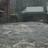 The normally calm waters of the Pootatuck River in Sandy Hook Center became quite  choppy midday on Monday, January 25, during the height of a rainstorm that swept through the area. The quick moving windy storm downed many tree limbs and electric lines, leading to scattered power outages across town.  (Gorosko photo)