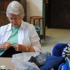 Pauline McCaffery works on a Chemo Cap at the Newtown Senior Center, Tuesday, April 20. Ms McCaffery is one of several volunteers who have been meeting weekly since the beginning of the month to create the special hats for cancer patients at the Praxair Center in Danbury. The volunteers are grateful for the anonymous donation of the nonbinding, machine washable, stretch material used to make the hats.  (Crevier photo)