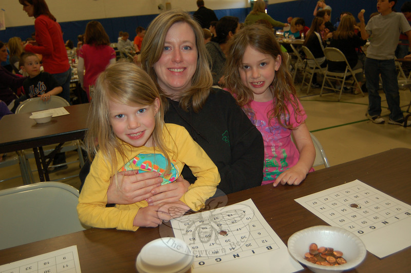Lisa Connor and her daughters Erin (left) and Paige were among those who attended Hawley Elementary School's Bingo Night on Tuesday, April 13, in the school's gymnasium.  (Hallabeck photo)