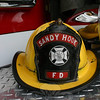 An early issue helmet, seen here, and coat from the first decades of Sandy Hook Volunteer Fire & Rescue Co.'s history was recently returned to the department. A family in Canada had donated the items to its local fire department, who in turn traced the protective gear to one of Newtown's fire companies.  (Hicks photo)
