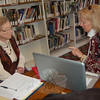 By appointment, genealogists with the Connecticut Professional Genealogists Council spoke to visitors at C.H. Booth Library on Saturday, April 10, and addressed their genealogy questions during The Ancestor Road Show hosted by The Genealogy Club of Newtown and the Connecticut Ancestry Society. In this photo genealogist Virginia Banerjee was meeting with Newtown resident Janis Bernard. The event was the first of its kind in Newtown, and all genealogists were booked during the event's hours.  (Hallabeck photo)