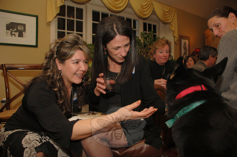 Friends Marcela Moayedi and Adelaida Egan give Polo a lot of attention as they took a moment during the Dinner for the Dogs event to pet him.  (Bobowick photo)