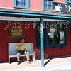 Ben Roberts relaxes with a cup of coffee on a bench outside of Mocha Coffeehouse on Glen Road in Sandy Hook Center. Mocha's owners, Rob Kaiser and Scott Wolfman, have decided to not renew the lease on their business, and the coffee house is slated to close June 1. Community supporters, rallied by Mr Roberts, have formed a grassroots group to Save Mocha Now.  (Crevier photo)