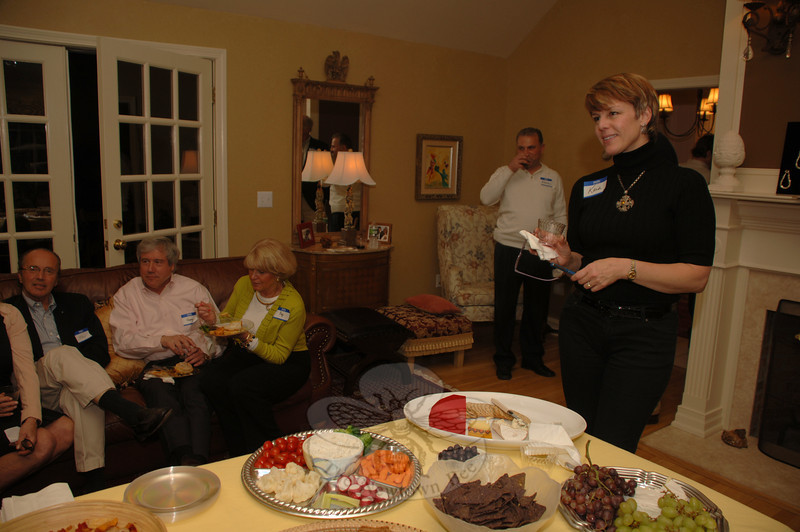 Dog Park Committee Chair Kaia Fahrenholz speaks to guests at a fundraising dinner party for the Newtown Park and Bark dog park. Roughly 40 supporters gathered at Ruth and Robert Hutchinson's home April 17.  (Bobowick photo)