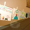 Hanging in the meeting room at Newtown Municipal Center earlier this month were winning entries from a schoolwide recycling poster contest. As students accepted congratulations prior to the April 5 Board of Selectmen's meeting, residents and officials could view their message to recycle and save the environment.  (Bobowick photo)