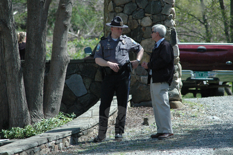 Newtown Police Patrol Officer Jeff Silver, left, and Detective Joe Joudy confer during a police homicide investigation at 89 Poverty Hollow Road.  (Gorosko photo)