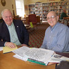 By appointment, genealogists with the Connecticut Professional Genealogists Council spoke to visitors at C.H. Booth Library on Saturday, April 10, and addressed their genealogy questions during The Ancestor Road Show hosted by The Genealogy Club of Newtown and the Connecticut Ancestry Society. In this photo is William Mayers of Brookfield (right) with genealogist Fred Hart of Guilford. The event was the first of its kind in Newtown, and all genealogists were booked during the event's hours.  (Hallabeck photo)