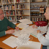 By appointment, genealogists with the Connecticut Professional Genealogists Council spoke to visitors at C.H. Booth Library on Saturday, April 10, and addressed their genealogy questions during The Ancestor Road Show hosted by The Genealogy Club of Newtown and the Connecticut Ancestry Society. In this photo genealogist Bill Stansfield of Fairfield was speaking with Carol Steffen of Brookfield. The event was the first of its kind in Newtown, and all genealogists were booked during the event's hours.  (Hallabeck photo)