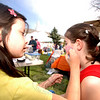 The third annual Newtown Earth Day Celebration took place on Saturday, April 24, at Newtown Middle School. Friends Talia Hankin, left, and Kaysie Fisher offered facepainting. (Bobowick photo)