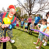 Zooky the clown worked hard throughout the day on April 24 to twist trick balloons into animals and other shapes that children loved. Quickly inflating a balloon, he entertained a gathering crowd.  (Bobowick photo)