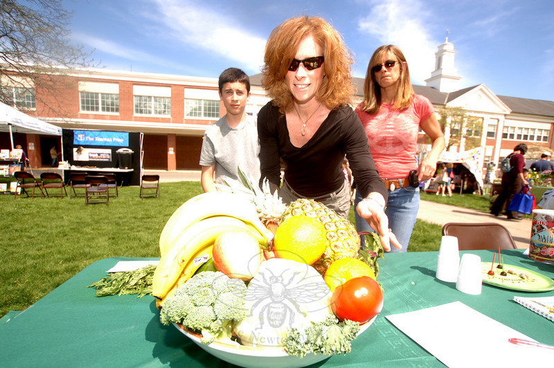 The third annual Newtown Earth Day Celebration took place on Saturday, April 24, at Newtown Middle School. Representing Juice Plus were Nolan Fisher, MaryAnn Fisher and Doris Hanley. (Bobowick photo)
