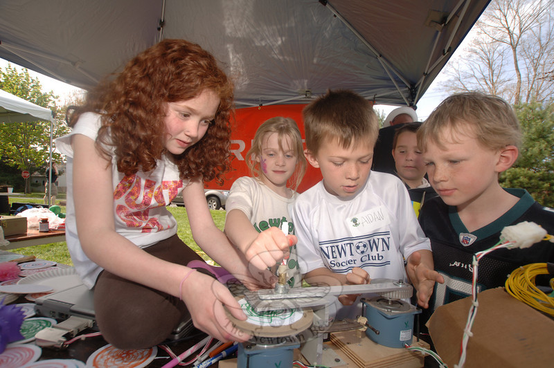 The third annual Newtown Earth Day Celebration took place on Saturday, April 24, at Newtown Middle School. Among the attendees were, from left, Sarah Wildmann, Olivia Buckler, and brothers Aidan and JP Ford.  (Bobowick photo)