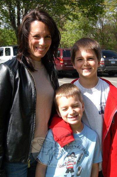 """In response to this week's Bee Lines question (What factors do you take into consideration when voting on the town budget?), Donna Hoffman, with sons Colin and Ethan, said """"I read the newspaper, and I try to keep on top of what is happening. And if it is not wasteful or excessive and whether it meets the community's needs.""""  (Hallabeck photo)"""