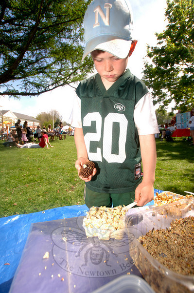 The third annual Newtown Earth Day Celebration took place on Saturday, April 24, at Newtown Middle School. Brendan Shugrue made a birdfeeder from suet, seeds, and a pinecone.  (Bobowick photo)