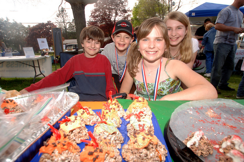 The third annual Newtown Earth Day Celebration took place on Saturday, April 24, at Newtown Middle School. Odyssey of the Mind teammates, from left, Dennis Timmons, Matt Brantl, Annika Alexander, and Monique Dubois sold volcano treats to raise funds during the special event. (Bobowick photo)