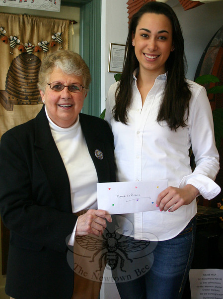 Anne LoPiccolo, right, was presented with her $2,000 Newtown VNA Mary M. Holian Scholarship by VNA Scholarship Committee Chair Sally Schwerdtle on April 2. Anne is a graduate of Laurelton Hall, and is currently a student at Fairfield University where she is studying for a bachelor of science degree in nursing (BSN). She has started her clinical rotation in the area of geriatrics. The Holian Scholarship is one of three financial awards presented annually by the local VNA chapter.  (Hicks photo)