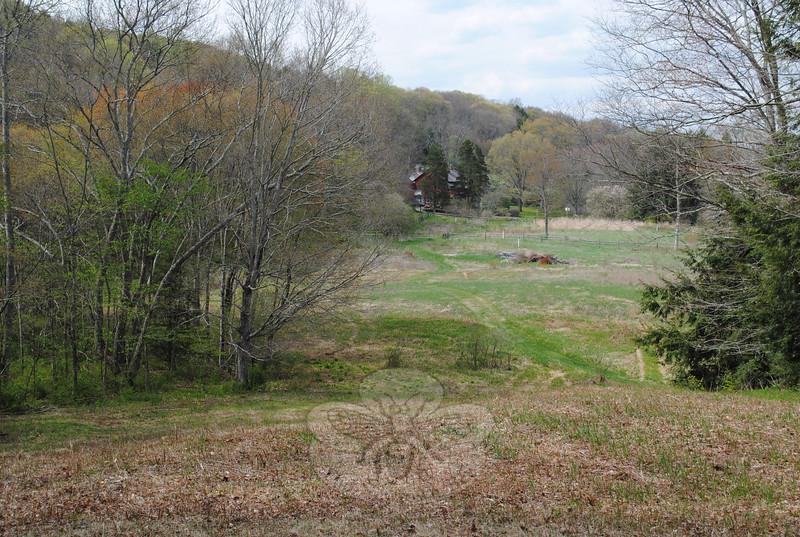 From the top of Memorial Hill, visitors to the 700-acre Bent of the River Audubon Center in South Britain can look over Althea's Meadow, to the historic red barn.  (Crevier photo)