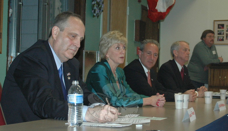 Newtown Senior Center was packed April 27 with interested residents and visitors who turned out to hear all four GOP contenders for the US Senate seat being vacated by Christopher Dodd. The 90-minute forum included opening and closing remarks, along with impromptu questions tendered by attendees. Participants included, from left, Vincent Forras, Linda McMahon, Peter Schiff and Rob Simmons.  (Voket photo)