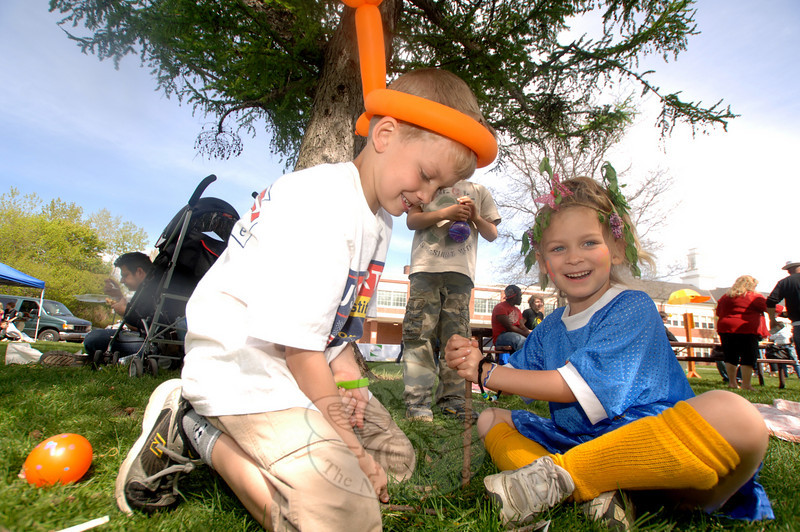 The third annual Newtown Earth Day Celebration took place on Saturday, April 24, at Newtown Middle School. Thomas and Paige Armstrong made stick towers on the lawn. (Bobowick photo)