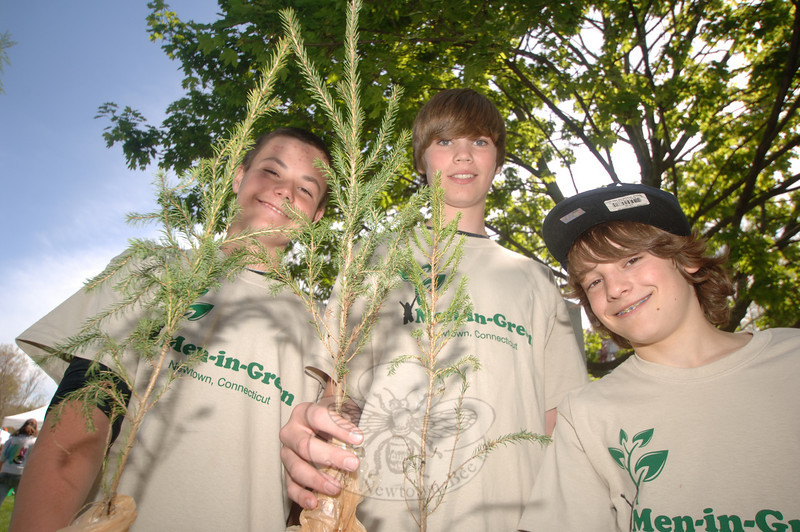 Men in Green environmental students with saplings in hand are, from left, Austin Raftery, Mike Davis, and Garrison Buzzanca.  (Bobowick photo)