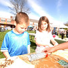 Sean and Alexa Gordon made seed pots from newspapers and potting soil during the third annual Newtown Earth Day Celebration on Saturday, April 24.  (Bobowick photo)