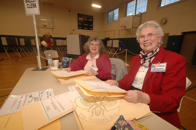 Ballot Clerks Betty Werner, left, and Lorraine Vanderwende collect voters' tickets in exchange for a blank ballot and folder during Tuesday's referendum.  (Bobowick photo)