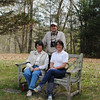 Bent of the River educational program manager Ken Elkins stands behind Newtown Audubon volunteer Jeanne Foege, left, and Bent of the River director Leslie Kane, seated on the bench at the top of Memorial Hill.  (Crevier photo)