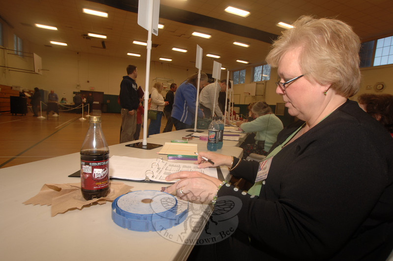 Anna Wiedemann works at the polls Tuesday.  (Bobowick photo)