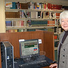 Beryl Harrison stands next to one of the 11 Internet stations in the reference department of C.H. Booth Library. Computer technology and the 1998 library addition have had the most impact on her job as reference librarian over the twenty years she has been on staff, she says.  (Crevier photo)