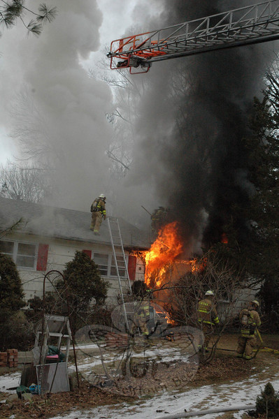 Approximately 90 firefighters, coming from six fire companies, responded to the scene of a house fire on Deerfield Drive on Tuesday, February 2.  (Gorosko photo)