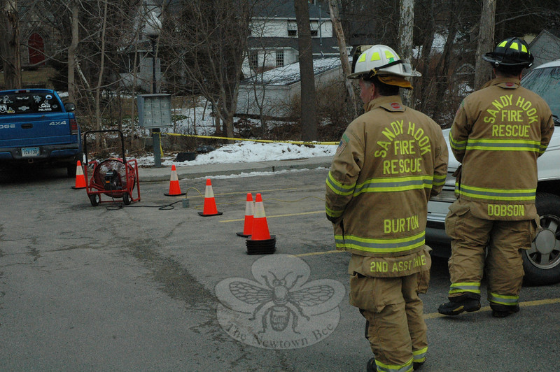 Sandy Hook firefighters responded to the retail plaza at 102 Church Hill Road in Sandy Hook Center about 1:27 pm February 2, after learning of the smell of propane gas in the area. They positioned a large ventilating fan there to disperse propane fumes that were rising to the surface from propane storage tanks buried beneath the parking lot. Firefighters called in a repairman to correct the gas storage equipment problem, which had apparently been caused by cold weather conditions.  (Gorosko photo)