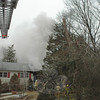 Firefighters from six volunteer fire companies battled an accidental blaze at a Deerfield Drive house in Sandy Hook on Tuesday, February 2. Damage estimates exceed $250,000.  (Gorosko photo)