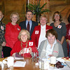 The Visiting Nurse Association of Newtown held its annual Kick-Off Bash to celebrate February as Heart Health Month on Tuesday at My Place Restaurant. Dr Robert Grossman, former chief of surgery at Danbury Hospital, (standing at left), and cardiologist Dr Harvey Kramer (standing, third from right), along with First Selectman Pat Llodra (also standing, second from left), offered reminders and suggestions on taking care of one's own heart as well as what to watch for in loves ones. Ms Llodra also presented the VNA with a proclama-tion officially announcing Friday, February 5, as Wear Red For Women Day in Newtown and February as Heart Health Month. With the guest speakers, also from left, are VNA president Anna Wiedemann, second vice president Becky Smith, first vice president Jill Collins. Seated are Mae Schmidle, treasurer and parliamentarian, left; and Maureen McLachlan, corresponding secretary.  (Hicks photo)