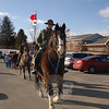 Volunteers from the Second Company Governor's Horse Guard escorted Reed Intermediate School students from the building and across the parking lot toward the Hawleyville Postmaster's truck last Friday. Students carried boxed and stamped packages of valentines for the St Valentine's Day Project that they wrote to troop members serving overseas.  (Bobowick photo)