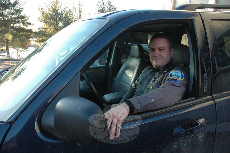 Police Patrol Sergeant Domenic Costello is behind the wheel of the police department's sport utility vehicle, which is used by sergeants who oversee the work of patrol officers. Sgt Costello will coordinate the upcoming Citizen Police Academy XV.  (Gorosko photo)