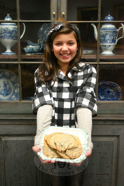 Sage DeSimone has always watched her mother cook, and loves Rachel Ray. The fifth grader is going through some of her favorite cookie recipes this month, and will host a Helping Haiti Bake Sale at Edmond Town Hall on February 20.  (Hicks photo)