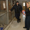 Assistant Animal Control Officer Matt Schaub and Animal Control Officer Carolee Mason enjoy a laugh while they settle the dogs in the kennels at the pound.  (Bobowick photo)