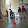 St Rose of Lima School faculty looked on as their homeroom's mechanical pig tried to make it to the finish line for a pig race during a pep rally at the school on Monday, February 1.  (Hallabeck photo)