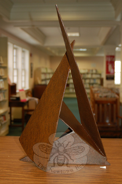 One of six pieces on display at C.H. Booth Library this month, artist Brian Walters says that this one is a perfect example of the use of positive and negative space, an important element of sculpture.  (Crevier photo)