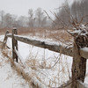 A split-rail fence bordering  a field on Great Ring Road collected snow Wednesday morning.  (Bobowick photo)