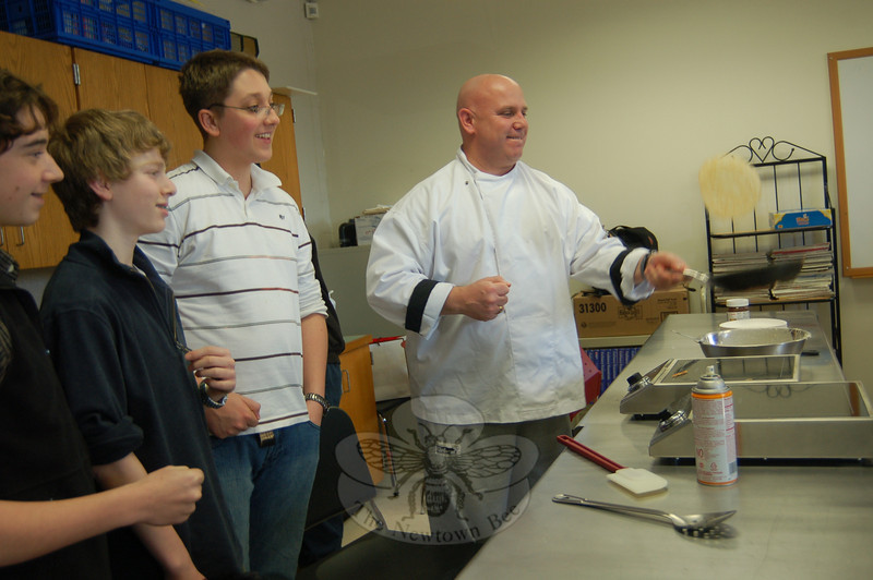 Newtown High School culinary teacher Stephen OShana demonstrates how to make a crepe for students in the French 2 Honors courses on Monday, February 1.  (Hallabeck photo)