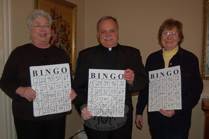 St Rose member Peggy Baiad, Monsignor Robert Weiss, and St Rose Women's Club president Cathy Hickey-Williams (from left) invite the public to Family Bingo Night, returning Saturday, February 27, at the St Rose Gathering Hall on Church Hill Road, sponsored by the Women's Club.  (Crevier photo)
