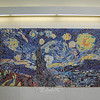 "A new mosaic mural created by students, faculty, staff and parents at Head O' Meadow now hangs in the school's front foyer. The two center panels of the project were inspired by Vincent van Gogh's ""Starry Night,"" and the outside two panels were inspired by other works by the post-Impressionist artist. The Art Spot of Danbury oversaw the project, which was funded by the school's PTA.  (Hallabeck photo)"