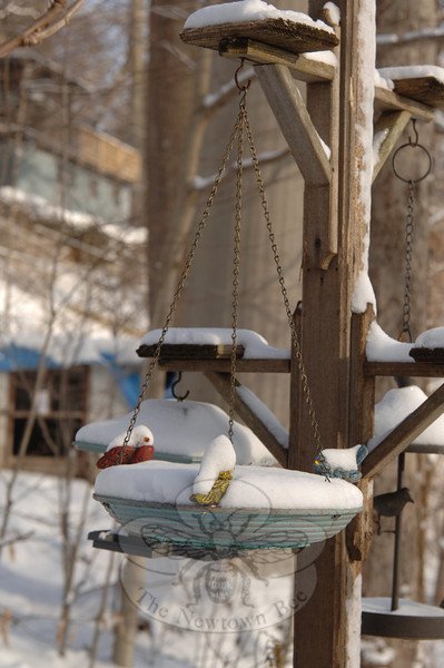 The not-so-stormy weather that dropped snow across the region was less than forecasters had predicted again this week. Birdbaths and feeders with decorative cardinals were still visible Thursday morning.  (Bobowick photo)