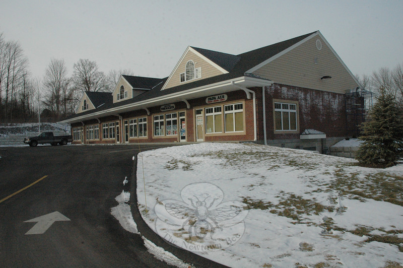 The Planning and Zoning Commission (P&Z) is considering a request to construct a 324-square-foot patio for restaurant patrons atop a rise adjacent to the nearest corner of this new commercial building at 23 Barnabas Road in Hawleyville. The P&Z approved construction of the 7,500-square-foot building at the southern corner of Barnabas Road and Haw-leyville Road (Route 25) in April 2007.  (Gorosko photo)