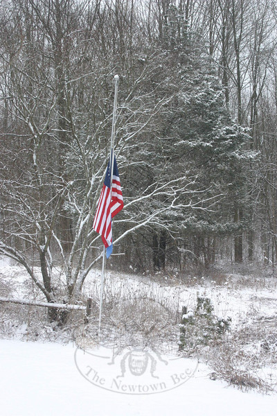 The flag at 2 Zoar Road had been lowered on Wednesday morning, following Governor Jodi Rell's order to lower flags across the state from sunup to sundown to honor the five men who were killed on Sunday, February 7, in the explosion at the Kleen Energy Systems plant in Middletown.  (Hicks photo)