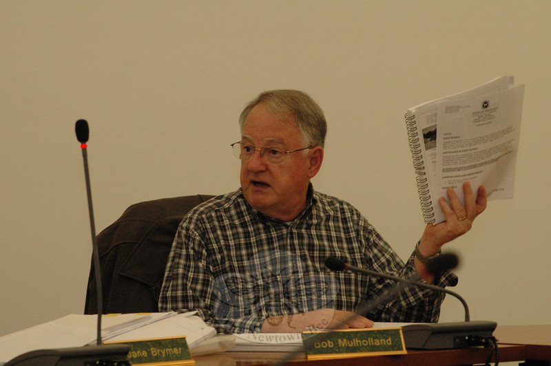 While holding a copy of the 2004 Town Plan of Conservation and Development at a February 4 session, Planning and Zoning Commission member Robert Mulholland makes a point about the P&Z's planned revision of the document, which is slated for completion by 2012.  (Gorosko photo)