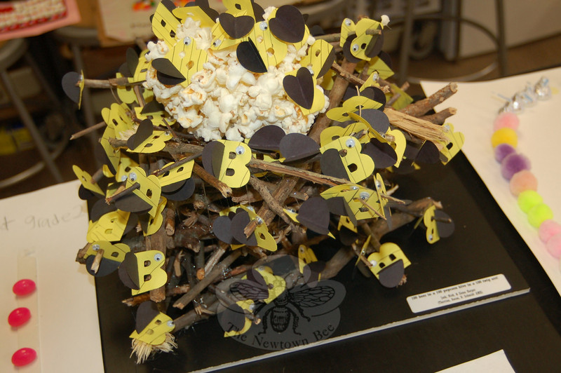 One of the projects in math/specialist Pam Fagan's classroom at Middle Gate School marking the 100th Day of School all-school math day celebration combined 100 bees, 100 pieces of popcorn, and 100 twigs to create a nest. The project was completed by siblings Josh, Nick and Siena Harper.  (Hallabeck photo)