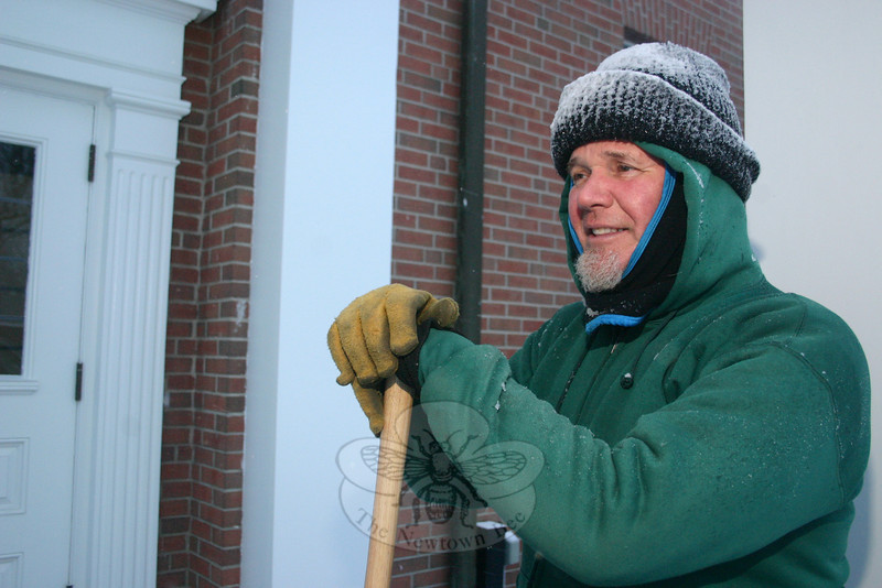 Steve Stohl, who takes care of maintenance for St Rose of Lima, took a break from shoveling as he neared the end of a double shift on Wednesday.  (Hicks photo)
